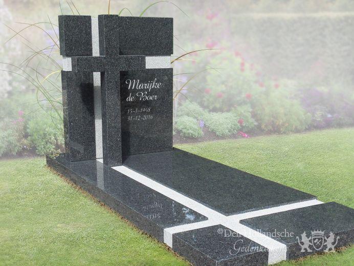 Grafsteen van zwart natuursteen met kruis